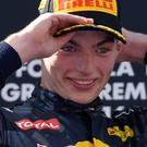 Max Verstappen celebrates on the podium after the Spanish Grand Prix