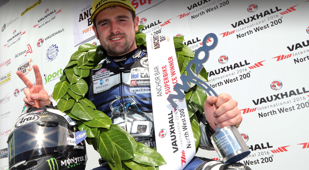 Top man: Michael Dunlop celebrates on the podium after his Superbike triumph at the North West 200