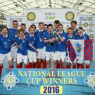 Glory boys: Linfield under-13s celebrate winning the cup
