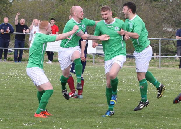 NAFL players celebrate with Elliott McKimm after his equaliser in this year's Rosebowl fixture (Pic supplied by Conrad Kirkwood)