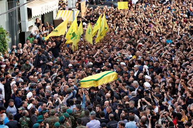 Hezbollah supporters carry the coffin of their slain commander Mustafa Badreddine, draped in a Hezbollah flag, during his funeral procession in a southern suburb of Beirut, Lebanon, Friday, May 13, 2016. (AP Photo/Hassan Ammar)