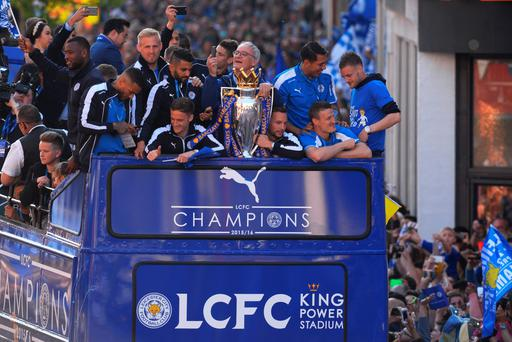 The Buses carrying the Leicester squad and trophy make their way through the the streets during the Leicester City Barclays Premier League winners bus parade on May 16, 2016 in Leicester, England. (Photo by Michael Regan/Getty Images)