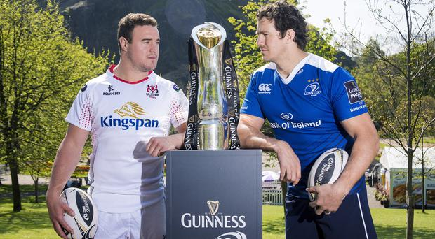 Eyes on the prize: Ulster's Rob Herring and Mike McCarthy of Leinster get a close look at the PRO12 trophy in Edinburgh