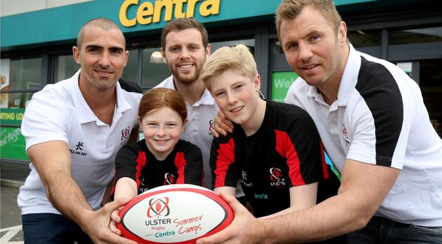 Summer fun: Ulster Rugby stars Ruan Pienaar, Darren Cave and Roger Wilson help young players Nathan and Abi Toland from Carrickfergus kick off the 2016 Centra Ulster Rugby Summer Camps