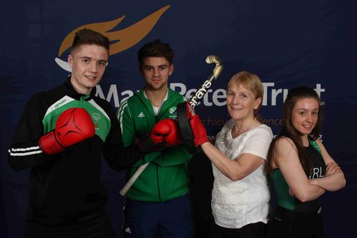 Helping hand: The Mary Peters Trust has once again helped 80 young athletes from across Northern Ireland to support their professional careers. Kane Tucker, Kyle Marshall and Lauren Strange, pictured with the Chairperson of the Mary Peters Trust Eilish Rutherford, all received funding at the Athlete Academy