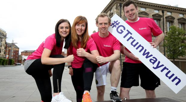 The Tughans team warming up for the Grant Thornton Runway Run