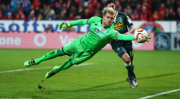 Loris Karius of FSV Mainz makes a save during the Bundesliga match between 1. FSV Mainz 05 and Borussia Moenchengladbach at Coface Arena on January 29, 2016 in Mainz, Germany. (Photo by Alex Grimm/Bongarts/Getty Images)