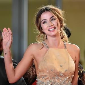 "Cuban actress Ana de Armas gestures as she arrives on May 16, 2016 for the screening of the film ""Hands of Stone"" at the 69th Cannes Film Festival in Cannes, southern France. AFP/Getty Images"