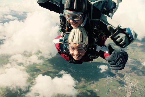 Clodagh Dunlop sky dives one year on from her locked in syndrome.