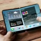 Samsung is reportedly planning on launching four other new smartphones next year. Above: A potential design for the foldable smartphone was demonstrated in a 2014 Samsung concept video. Image: Samsung