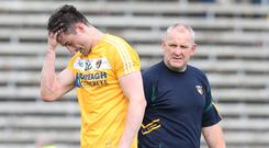 Bitter blow: Antrim's Niall McKeever and boss Frankie Fitzsimmons after defeat in last year's qualifiers
