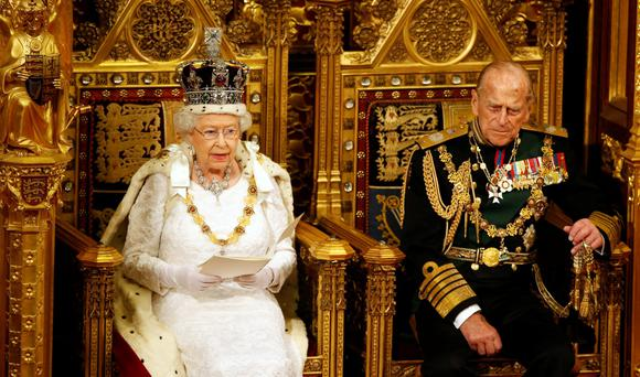 LONDON, ENGLAND - MAY 18: Queen Elizabeth II reads the Queen's Speech on her thrown as Prince Philip, Duke of Edinburgh listens during State Opening of Parliament in the House of Lords at the Palace of Westminster on May 18, 2016 in London, England. The State Opening of Parliament is the formal start of the parliamentary year. This year's Queen's Speech, setting out the government's agenda for the coming session, is expected to outline policy on prison reform, tuition fee rises and reveal the potential site of a UK spaceport. (Photo by Alastair Grant - WPA Pool/Getty Images)