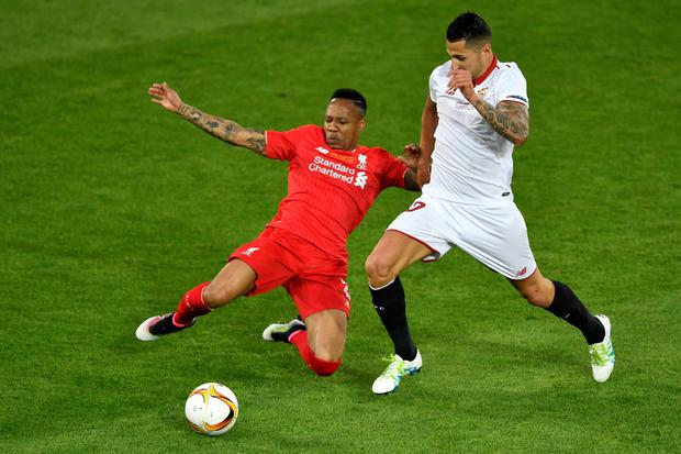 Liverpool's English defender Nathaniel Clyne (L) vies with Sevilla's midfielder Vitolo during the UEFA Europa League final football match between Liverpool FC and Sevilla FC at the St Jakob-Park stadium in Basel, on May 18, 2016. AFP PHOTO / FABRICE COFFRINIFABRICE COFFRINI/AFP/Getty Images