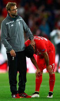 No Can do : Liverpool boss Jurgen Klopp consoles player Emre Can after last night's Europa League final defeat