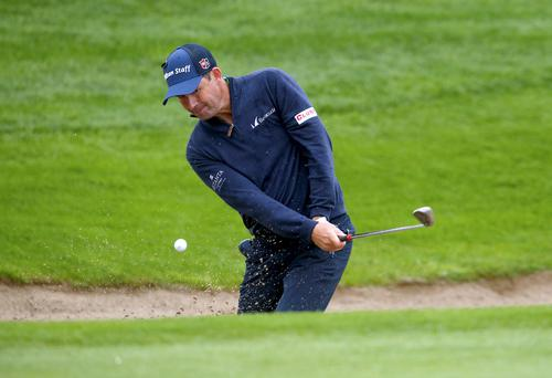 Ireland's Padraig Harrington plays out of a bunker to the 14th green during day one of the Irish Open at The K Club, County Kildare. PA