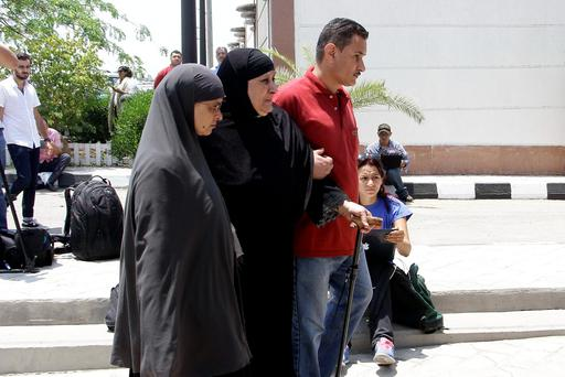 Relatives of passengers on an EgyptAir flight that crashed early Thursday walk past journalists at Cairo International Airport, Egypt, Thursday, May 19, 2016. The EgyptAir jetliner bound from Paris to Cairo with 66 people aboard crashed in the Mediterranean Sea early Thursday after swerving wildly in flight, authorities said, and Egypt said it may have been a terrorist attack. (AP Photo/Ahmed Abd el Fattah)