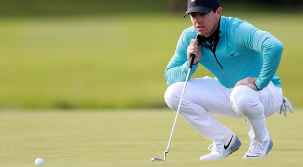 Lining it up: Rory McIlroy focuses on a putt yesterday at the K Club where he carded a 67, equalling his best performance in the opening round of an Irish Open to date