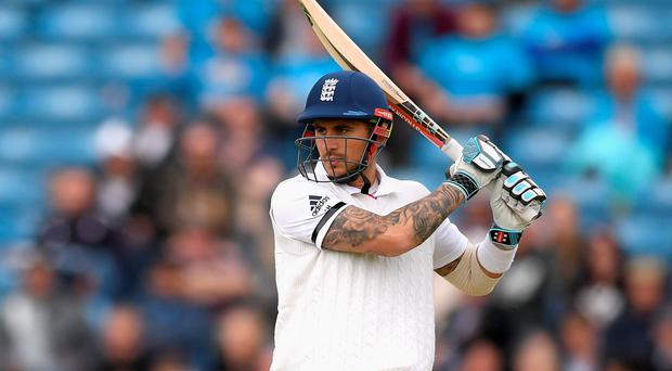 Alex Hales batted through a shortened first day for England while losing five partners
