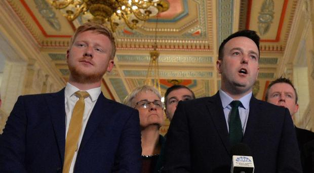 The SDLP leader Colum Eastwood is flanked by his party colleagues as he announces that they will go into opposition at Stormont