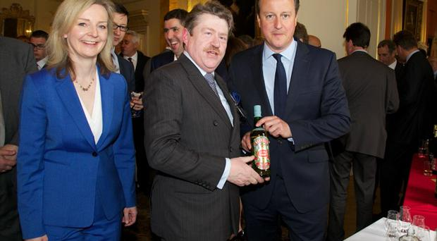 Roger Lomas with David Cameron and Elizabth Truss, Secretary of State for Environment, Food and Rural Affairs