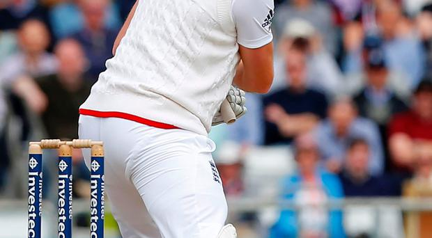 England's Jonny Bairstow hits a boundary on the second morning of the first cricket Test match between England and Sri Lanka at Headingley in Leeds