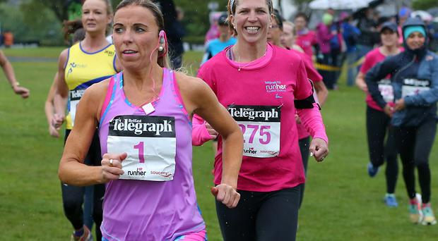 Belfast Telegraph Coastal Runher 5k and 10k at Seapark in Holywood. The start of the 10k and Cathy Mc Court leads the runners away. Photograph by Declan Roughan