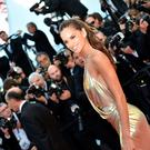 "Brazilian model Izabel Goulart poses as she arrives on May 20, 2016 for the screening of the film ""The Last Face"" at the 69th Cannes Film Festival in Cannes, southern France. / AFP PHOTO / ALBERTO PIZZOLIALBERTO PIZZOLI/AFP/Getty Images"