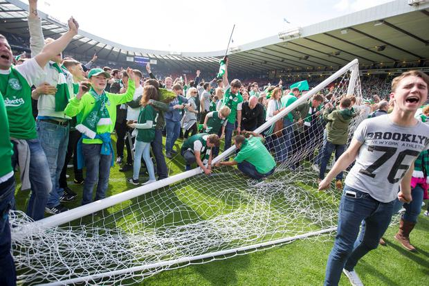 Hibernian fans invade the pitch after the William Hill Scottish Cup Final, at Hampden Park, Glasgow. Jeff Holmes/PA Wire.