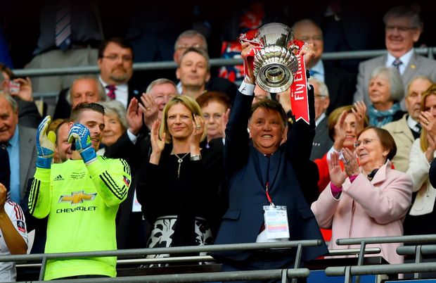 Parting gift: Louis van Gaal lifts the FA Cup at Wembley after Manchester United triumphed 2-1 against Crystal Palace