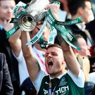 Get in: Anthony Stokes lifts the cup after Hibernian's victory