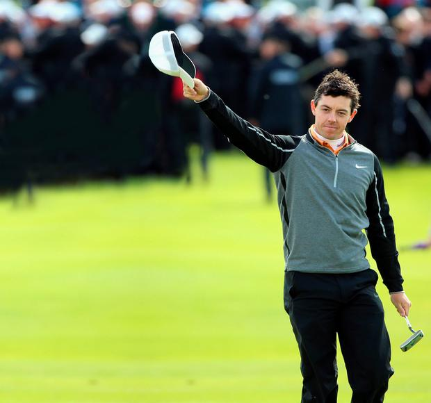 Hats off: Rory McIlroy celebrates winning the Irish Open