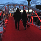 The Sam Thompson bridge lit up in red last night