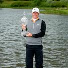 Rory McIlroy gets his hands on the Irish Open Crown