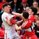 Tussle: Cathal McCarron of Tyrone, Niall Toner and Danny Heavron