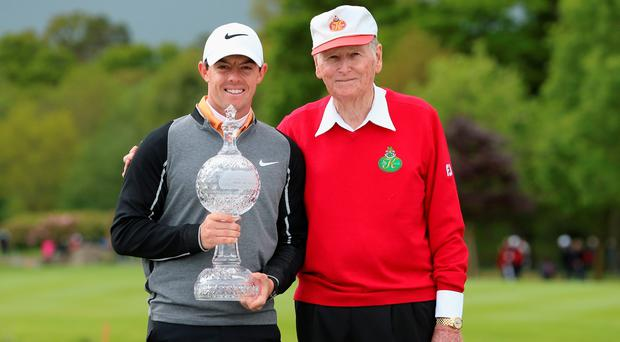 Rory McIlroy of Northern Ireland and Dr Michael Smurfit, the owner of The K Club, pose with the trophy after winning the Dubai Duty Free Irish Open Hosted by the Rory Foundation at The K Club on May 22, 2016 in Straffan, Ireland. (Photo by Andrew Redington/Getty Images)