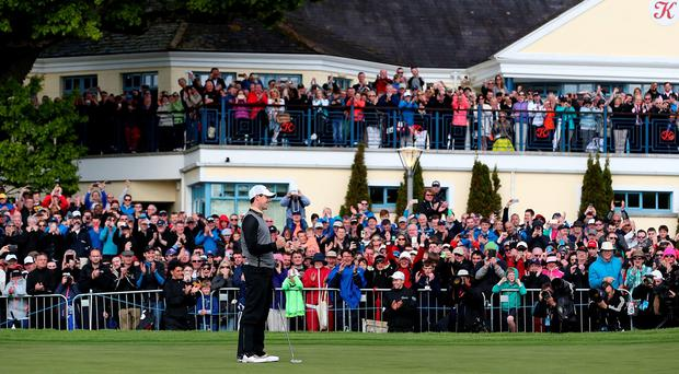 Rory McIlroy celebrates on the 18th green following his victory during last year's Dubai Duty Free Irish Open