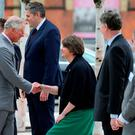 Northern Ireland First Minister Arlene Foster curtseys for The Prince of Wales as he arrives at the Northern Ireland Science Park at Queen's University Belfast, where he officially launched the University's first Global Research Institute.Niall Carson/PA Wire