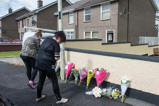 Friends leave flowers at Milldale Crescent in Currynierin where Gerard Quinn died