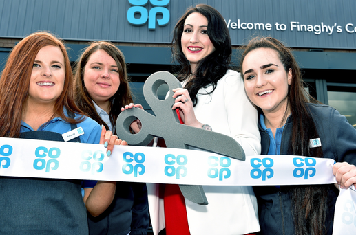 From left: Eimear Mallon, Amanda Lillington and Leanna King from Finaghy Co-op watch as South Belfast MLA Emma Pengelly (second right) cuts the ribbon at the relaunch of the store