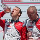 Drinking it all in: Ulsterman Kris Meeke (second left) toasts his Rally Portugal victory on the podium with co-driver Paul Nagle