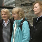 Diana King, Collette Devlin and Kitty O'Kane outside Strand Road police station yesterday