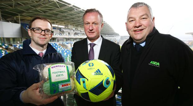 Pictured at Windsor Park is Chris Moore, National Account Manager, Irwin's Bakery, Northern Ireland Manager Michael O'Neill and Billy Clelland, Quality Manager Northern Ireland, Asda.