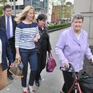 Beatrice Worton, (right), the mother of victim Kenneth Worton, arrives at Belfast Coroners Court accompanied by relatives