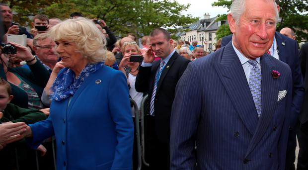 The Prince of Wales and the Duchess of Cornwall are greeted by well wishers as they visit Donegal Town in the Republic of Ireland in the latest royal bid to solidify transformed Anglo-Irish relations. PRESS ASSOCIATION Photo. Picture date: Wednesday May 25, 2016. See PA story IRISH Charles. Photo credit should read: Niall Carson/PA Wire