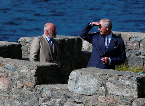 The Prince of Wales and the Duchess of Cornwall ontop of the boat house at Glenveagh Castle in Glenveagh National Park, Co Donegal, as his visits the Republic of Ireland in the latest royal bid to solidify transformed Anglo-Irish relations. PA
