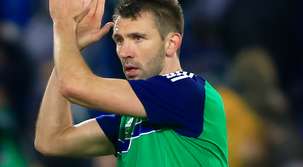 Taking the applause: Gareth McAuley could play at Windsor for the last time against Belarus after admitting he will decide his future after the Euros