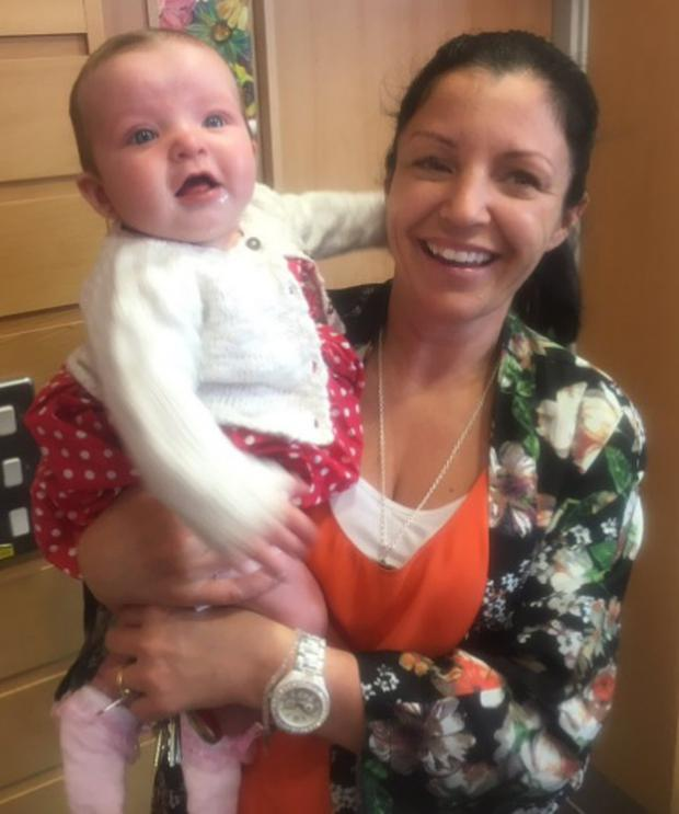 Louise James and baby Rioghnach-Ann at St Mary's College in Derry