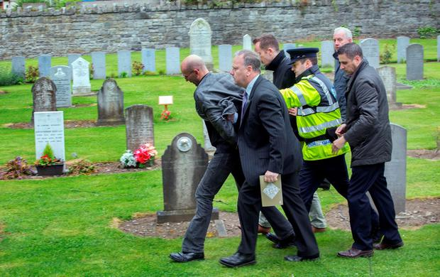 A protester is led away by gardai at the state event marking the deaths of British Soldiers in The Easter Rising at Grangegorman cemetery today. Photo: Tony Gavin 26/5/2016