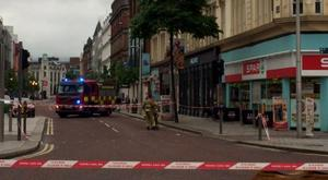 Police and fire and rescue services are at the scene of a blaze in Belfast's Castle Place