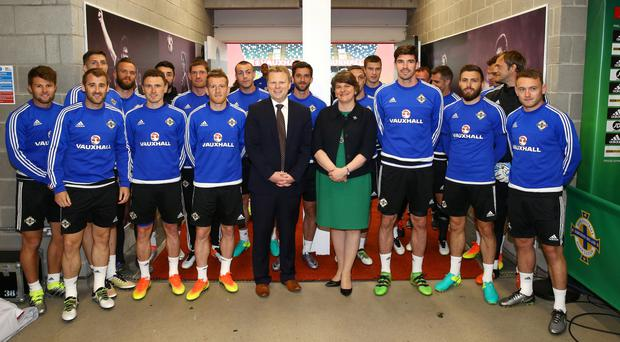 First Minister Arlene Foster and Junior Minister Alastair Ross dropped in on the Northern Ireland teams final training session for their match against Belarus at Windsor Park this afternoon. The First Minister posed for a team picture with Michael O'Neill's squad and passed on her best wishes for this summer's Euro 2016 tournament, before they head off to Austria for a week-long training camp next week. Photo By William Cherry / Press Eye.
